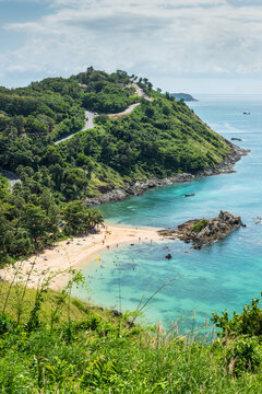 Birdview of beautiful quiet little cove landscape of Yanui Beach and Promthep Cape seen from the Windmill viewpoint located in the south of Phuket Island, Thailand.