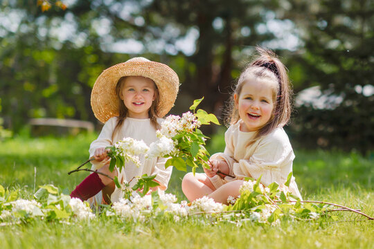 portrait of two girls sisters in nature