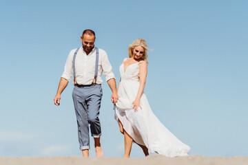 happy newly married couple on the beach. Wedding on the beach