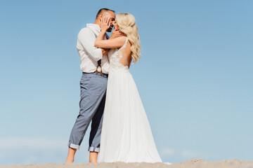 happy newly married couple kiss on the beach. Wedding on the beach