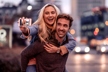Couple taking a selfie in the city.