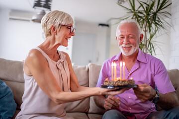 Senior couple celebrating at home.