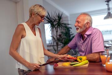 Senior couple preparing healthy food.