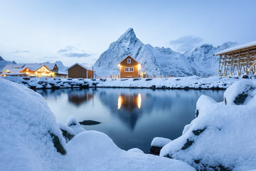 View on the house in the Sarkisoy village, Lofoten Islands, Norway. Landscape in winter time during blue hour. Mountains and water. Travel - image