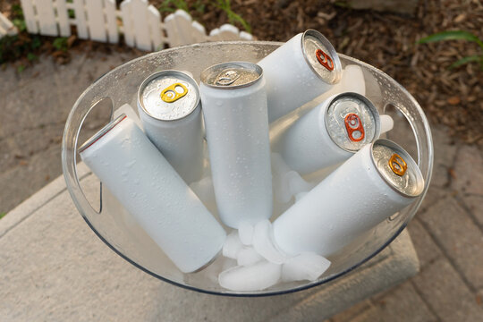 White Hard Seltzer Beverage Cans in Clear Ice Bucket Backyard High Angle