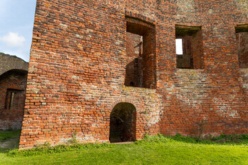 The wall and window openings from the courtyard of the ruin castle Teylingen in the south-holland village of Sassenheim in the Netherlands.