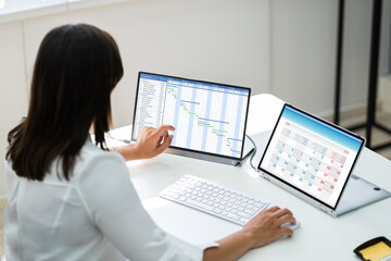 Employee Working On Calendar Schedule