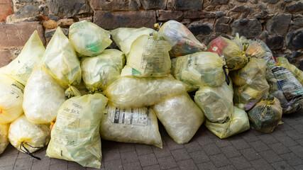 Yellow trash bags on street