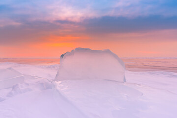 Beautiful frost ice water lake with sunlight skyline background, Baikal Russia winter season natural landscape