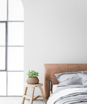Minimal farmhouse bedroom design, interior wall mockup with brown leather bed on white wall background, 3d render