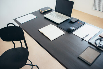 Home office interior. Workplace with laptop and office supplies. Workplace