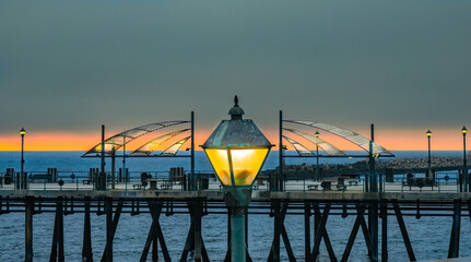 Light comes on at dusk at pier