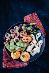 Healthy Fruit Halloween Treats. Banana Ghosts, Clementine Orange Pumpkins, Lychee Eyes and Green Witch Fingers Cookies