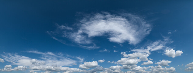 White cumulus clouds in blue sky panoramic high resolution background