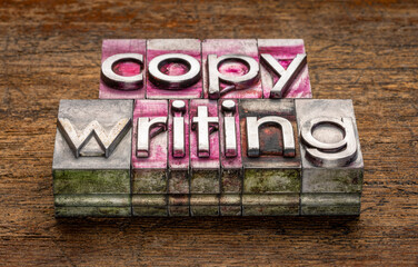 copywriting - text in vintage letterpress metal type blocks on a grunge, weathered wood, business, marketing and public relations concept