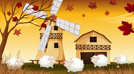 Farm scene in nature with barn and windmill and sheep in autumn season