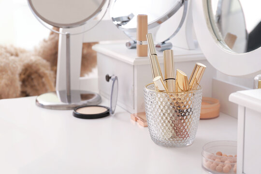 Set of decorative cosmetics on dressing table