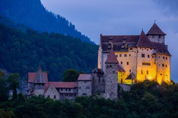Night view of illuminated medieval Gutenberg Castle on hilltop in Balzers village on summer, Liechtenstein