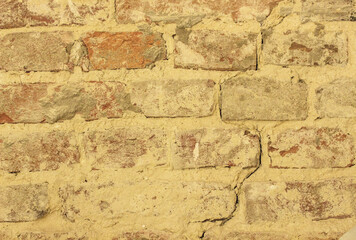 Brick wall background made of different  and textures