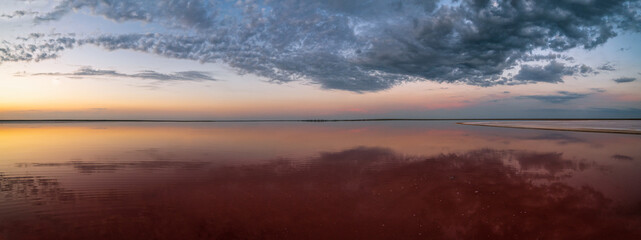 Sunset on the Genichesk pink extremely salty lake (colored by microalgae with crystalline salt depositions), Ukraine.