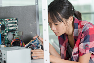 female engineer working with circuits