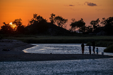 Cove Fishing at Sunset