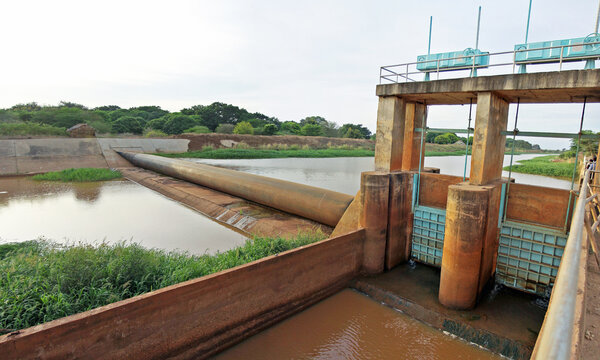 Garsen, Kenya: inflatable weir and gates in an irrigation canal in the Tana delta