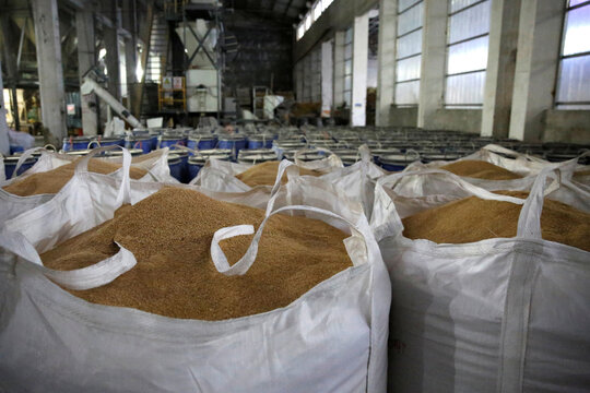 Sacks of feed ingredients are seen inside a feed plant of the New Hope Liuhe in Xichang, during a government-organised media tour in Liangshan