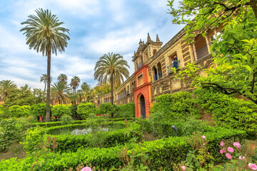 Seville, Andalusia, Spain - April 19, 2016: aerial view of gardens of Royal Alcazars of Seville or Reales Alcazares de Sevilla, Andalusian Architecture and old Arab Palace originally fort of Moors.