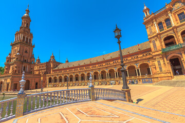 Seville, Andalusia, Spain - April 18, 2016: Leon Bridge with azulejos decorations and architecture with columns and arches in Plaza de Espana or Spanish Square, Seville, Andalusia.