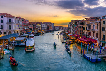 Grand Canal with gondolas in Venice, Italy. Sunset view of Venice Grand Canal. Architecture and landmarks of Venice. Venice postcard