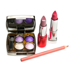 eye shadow, lipstick and cosmetic pencils isolated on a white background.