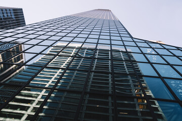 Fototapeta Contemporary high rise building with reflection of street