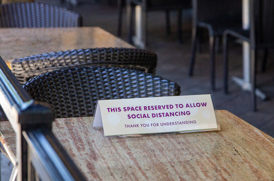 Social Distancing Signs on Tables at a Fort Lauderdale Restaurant