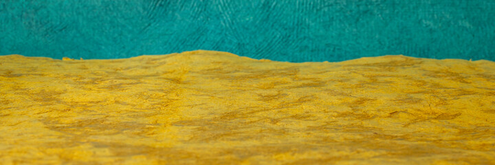 colorful abstract landscape in yellow and blue - a collection of colorful handmade Mexican bark papers, panoramic web banner