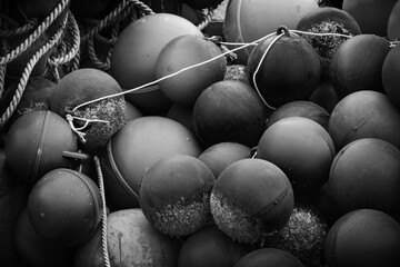 Spherical plastic floats of fishing nets lay in port