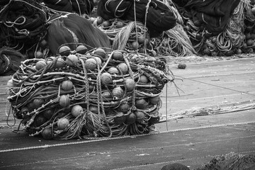 Drying fishing net lays on the sea coast in port