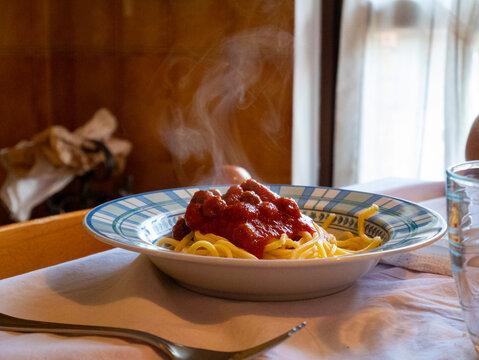 Italian spaghetti alla chitarra fresh pasta with tomato sauce, italian food homemade recipe, traditional Italian family meal, meatball pasta