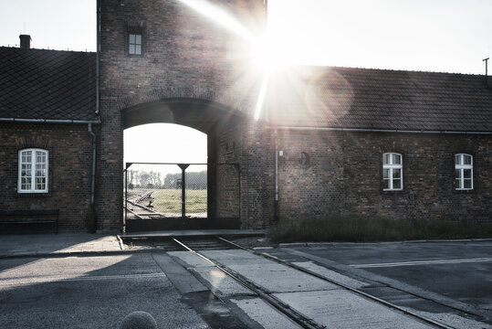 Oswiecim, Auschwitz Birkenau, Poland, 15 June 2020, Nazi prison camp and extermination. A place of memory and death of people during the Second World War. View of the entrance gate to Birkenau.