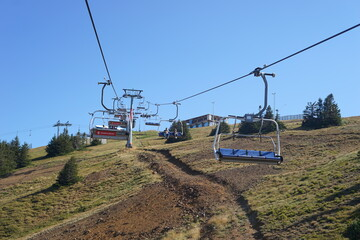 September 12th 2020, Kopaonik Serbia: Ski center in summer day scenic view on the cable car ropeway climbing to the top of the mountain in summer day between the trees in the ski center
