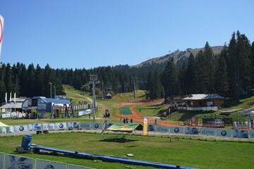 September 12th 2020, Kopaonik Serbia: Ski track in summer day on famous ski center with tourists on the field