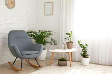 Wall Mural - Interior of room with stylish armchair and houseplants