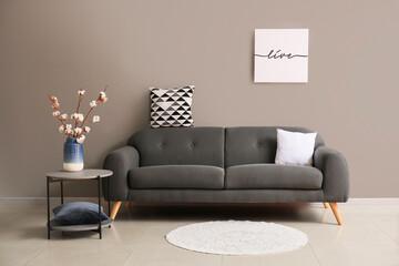 Wall Mural - Comfortable sofa near grey wall in room