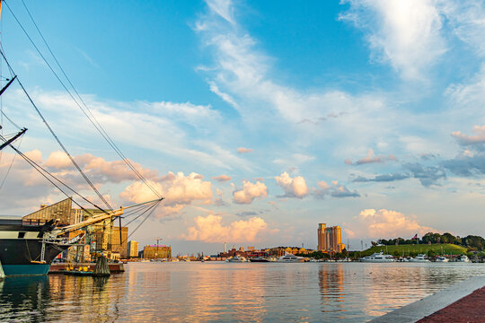 Baltimore, Maryland, US - September 4, 2019 View of Baltimore Harbor with buildings, yacht and boat