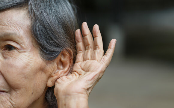 Elderly woman hearing loss , Hard of hearing