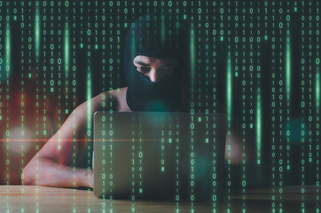 Hacker and malware concept. Hacker man using laptop Hacking the Internet.