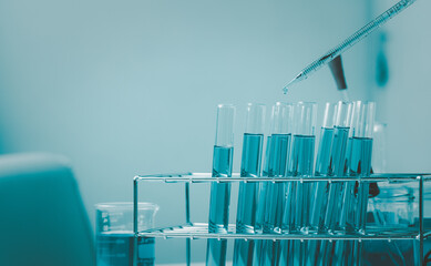 Pipette dropping a sample into a test tube and science experiments ,Laboratory glassware containing chemical liquid,