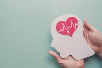 Hands holding paper brain and heart, world heart day, world mental health day, Alzheimer and wellness concept Wall mural