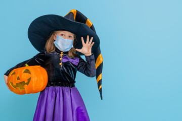 witch with a pumpkin wearing face mask