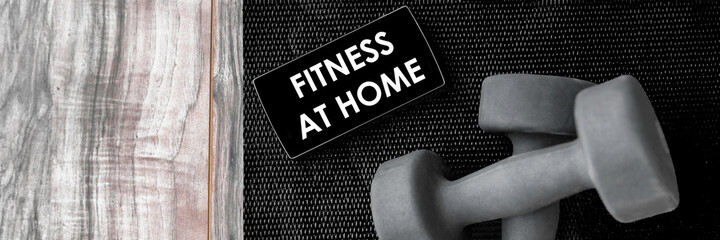 Fitness at home online streaming class for gym workout with free weights on mobile phone screen. Banner of dumbbells on exercise mat and smartphone for health progress tracking app.
